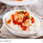 Grits topped with creole shrimp