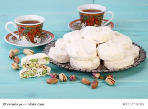 Traditional Iranian and Persian pieces of white nougat dessert sweet candies (Gaz) with Pistachio