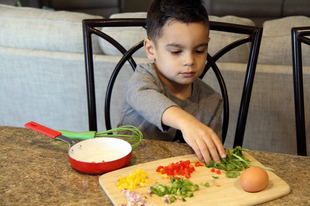 Little chef busy with food prep