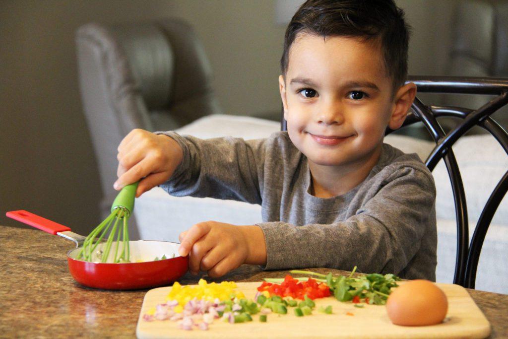 Kids in the kitchen whisking ingredients