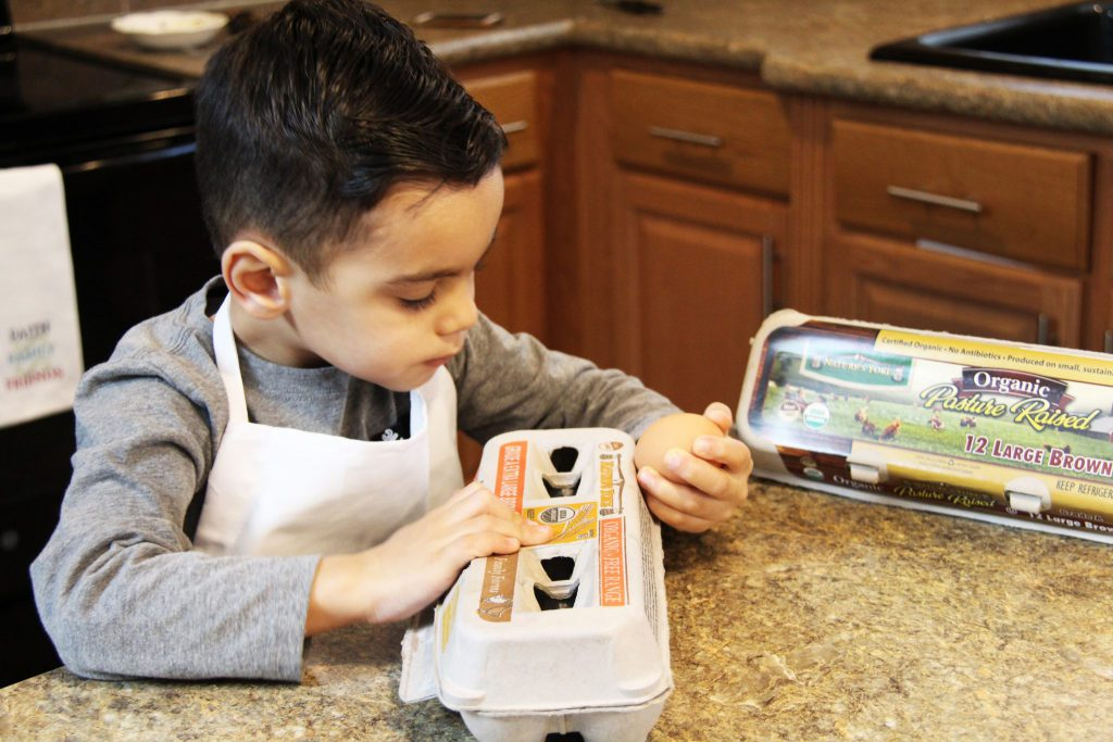 Little chef examining egg