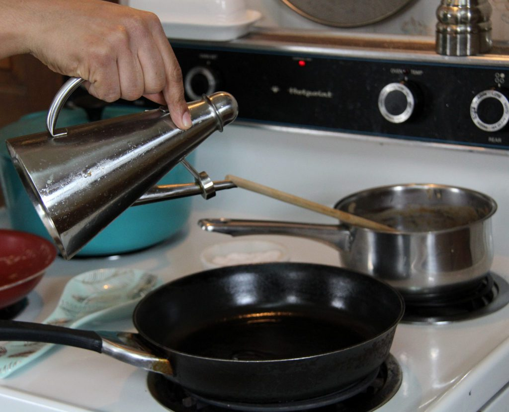 Pouring oil into pan