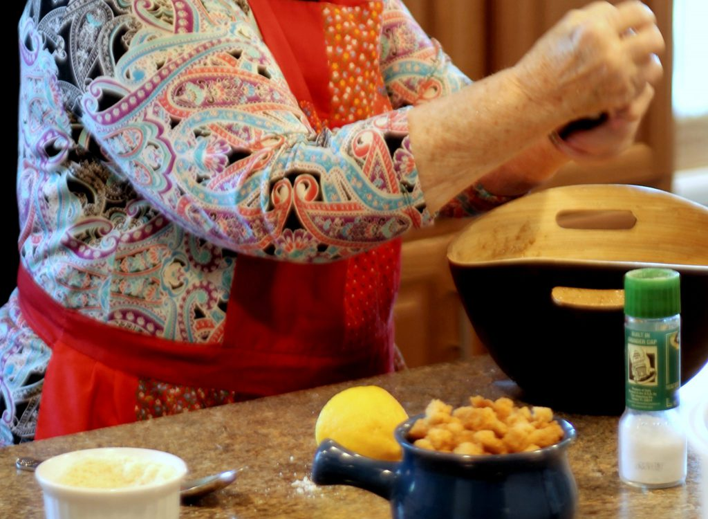 Grinding pepper for Caesar Salad